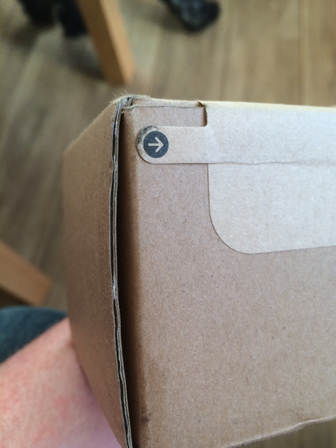 External packaging with tab for ease of open